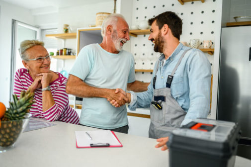 Auckland-electrician-happily-shakes-hand-with-elderly-couple
