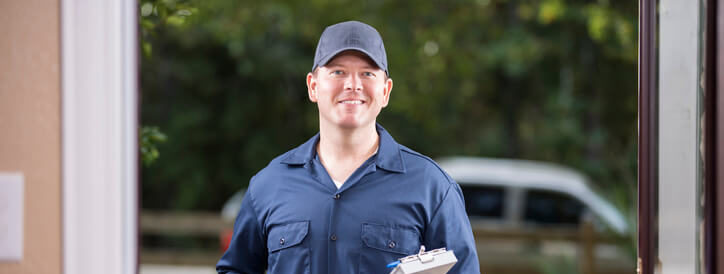 residential-electrician-stands-infront-of-the-door-to-explain-what-is-a-residential-electrician-is-about